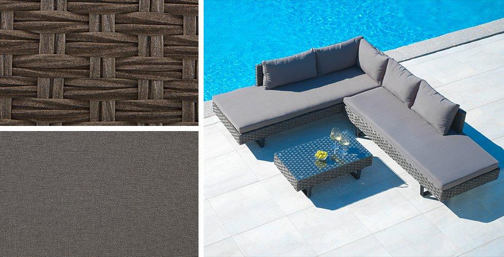 Großzügige Loungegarnitur aus dunkelgrauen Polyrattangeflecht bietet einen gemütlichen Sitzplatz für laue Sommernächte.