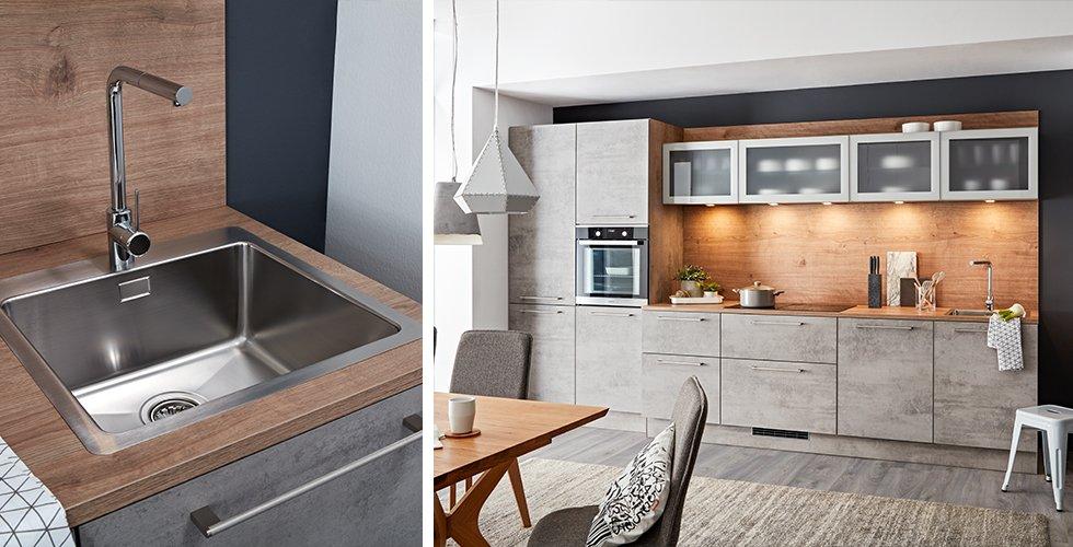Viereckige Einbauspüle in Edelstahl in einer grauen und braunen Küche von mömax.