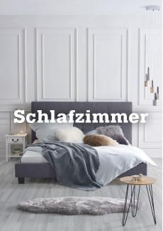 mömax Schlafzimmer mit Boxspringbett in Grau und weißer Holzwand
