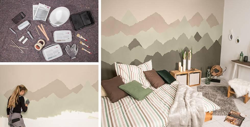 Wandgestaltung mit gemaltem Bergpanorama in Rosé- und Grau-Nuancen.