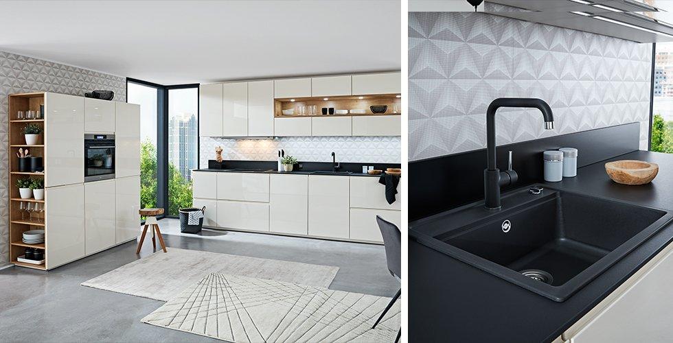 Schwarzes Spülbecken in der Arbeitsplatte, in einer modernen weißen Küche von mömax.