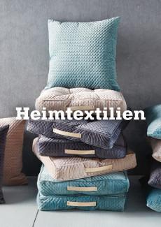Heimtextilien von mömax - kuschelig weich, wie diese Kissen in Pastellfarben