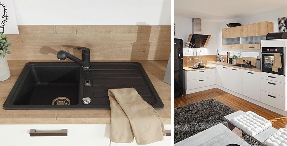 Edle Spüle in der Küche in Schwarz, schwarzer Wasserhahn, weiße Küche.