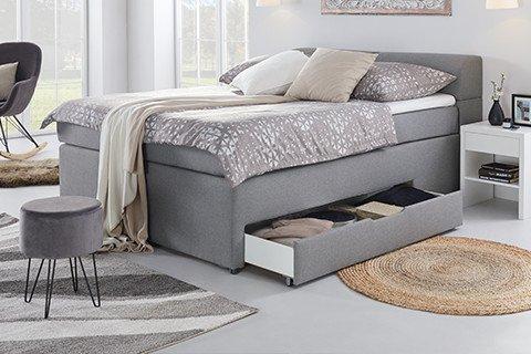 Schlafzimmer-Betten-Features-Boxspringbett-Grau-Stauraum-Schublade-Bettkasten-moemax2