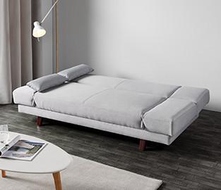 Hellgraue Couch mit Schlaffunktion von mömax.