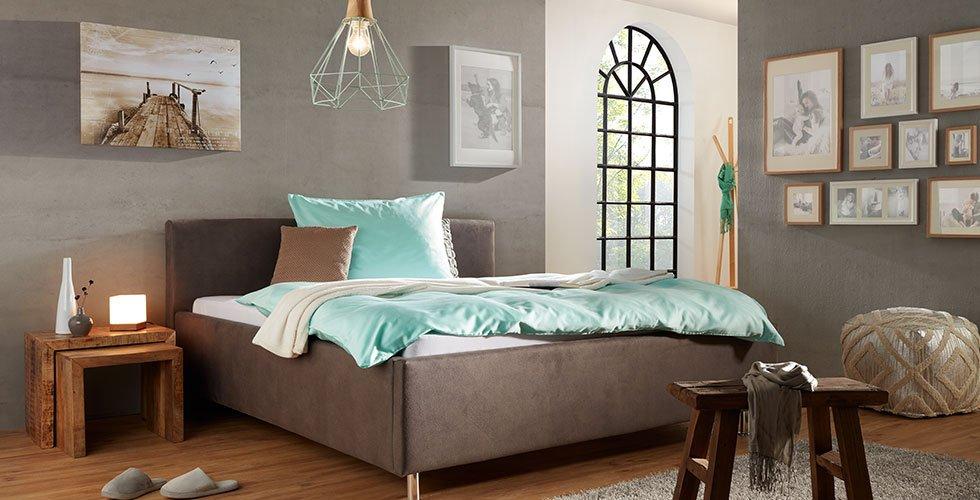 Siva oblazinjena postelja mömax