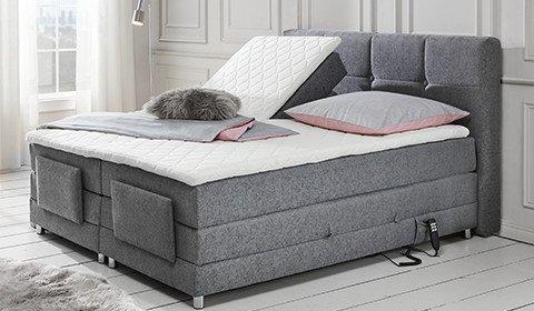 Schlafzimmer-Boxspringbettbett-Grau-Liegekomfort-moemax